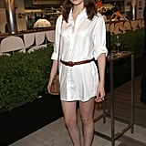 Tali Lennox perfected cool seasonal style, playing off a basic white shirtdress with metallic heels and a fedora.