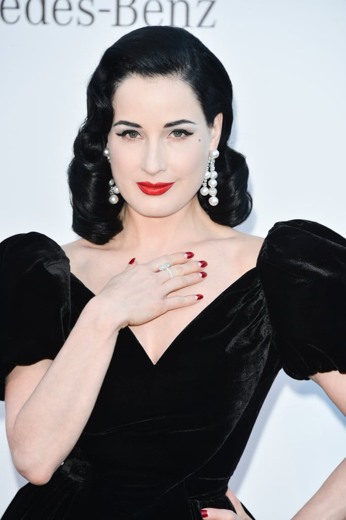 Also spotted at the amfAR event, Dita Von Teese wore her signature red-moon-manicured nails.