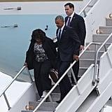 Florida Democratic Representative Corrine Brown and Florida Republican Senator Marco Rubio walk with President Obama after he lands at the Orlando International Airport.