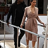 When they disembarked a yacht at Cannes, Kim was dressed to the nines, and Kanye was dressed to hang.