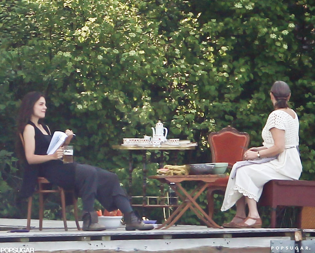 Katie Holmes held a book while filming her next project.