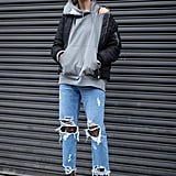 With a hoodie, bomber, and booties that look infinitely cooler with ripped jeans