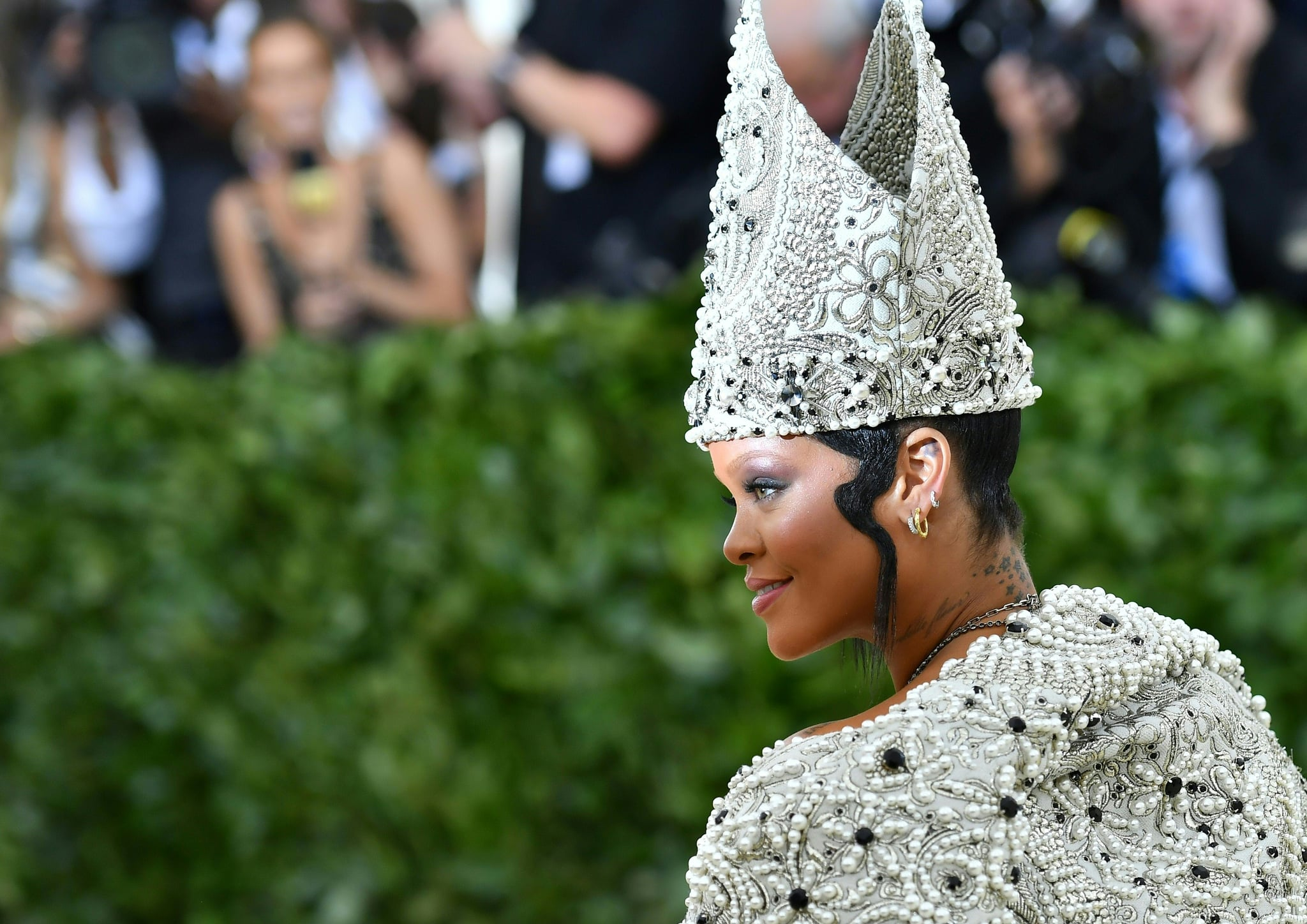 Rihanna arrives for the 2018 Met Gala on May 7, 2018, at the Metropolitan Museum of Art in New York. - The Gala raises money for the Metropolitan Museum of Arts Costume Institute. The Gala's 2018 theme is Heavenly Bodies: Fashion and the Catholic Imagination. (Photo by Angela WEISS / AFP)        (Photo credit should read ANGELA WEISS/AFP via Getty Images)
