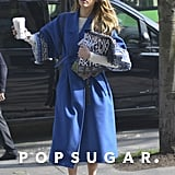 Jessica stayed warm (and caffeinated) on her way to the Kenzo show wearing a blue wrap coat from the brand's Fall '13 collection, which she layered over a long-sleeved white dress from their Pre-Fall line. To crib her colorful look, we suggest throwing on your favorite LWD and topping it with this Maison Scotch One-Button Coat ($180, originally $305). For a Spring-ready spin, try these Roberto Del Carlo Wedge Sandals ($370).