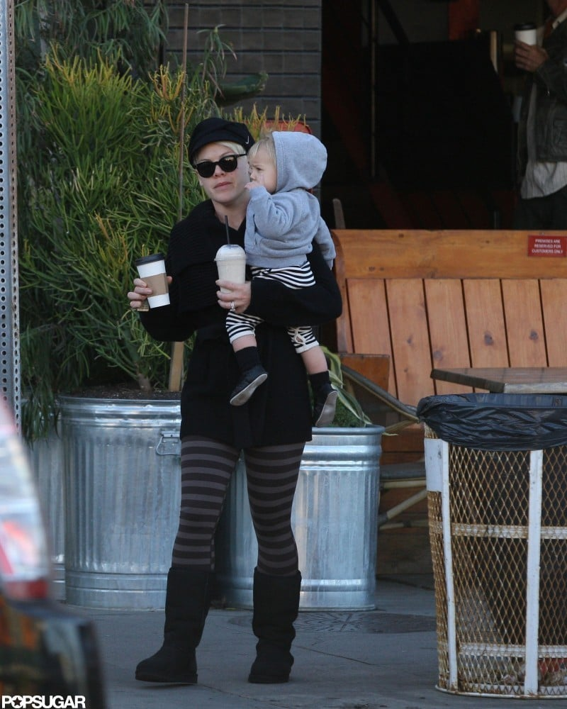 Pink had her hands full as she ran an errand with Willow Hart.