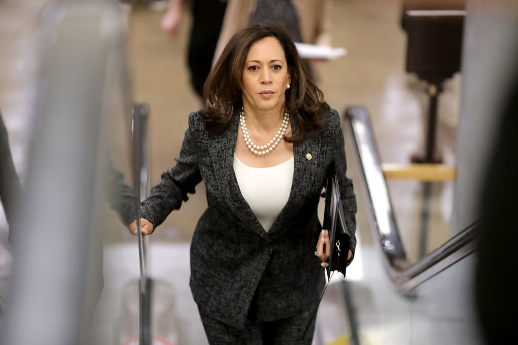 Kamala meant business as senator at the US Capitol in May 2017, coordinating her pearls with a sleek, fitted top underneath her cross-stitch salt-and-pepper pantsuit.