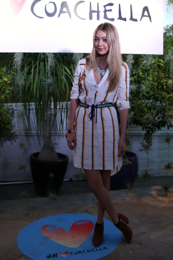 Gigi Hadid worked her lightweight striped H&M dress with the perfect marriage of turquoise accessories: a choker statement necklace and tie-front belt.
