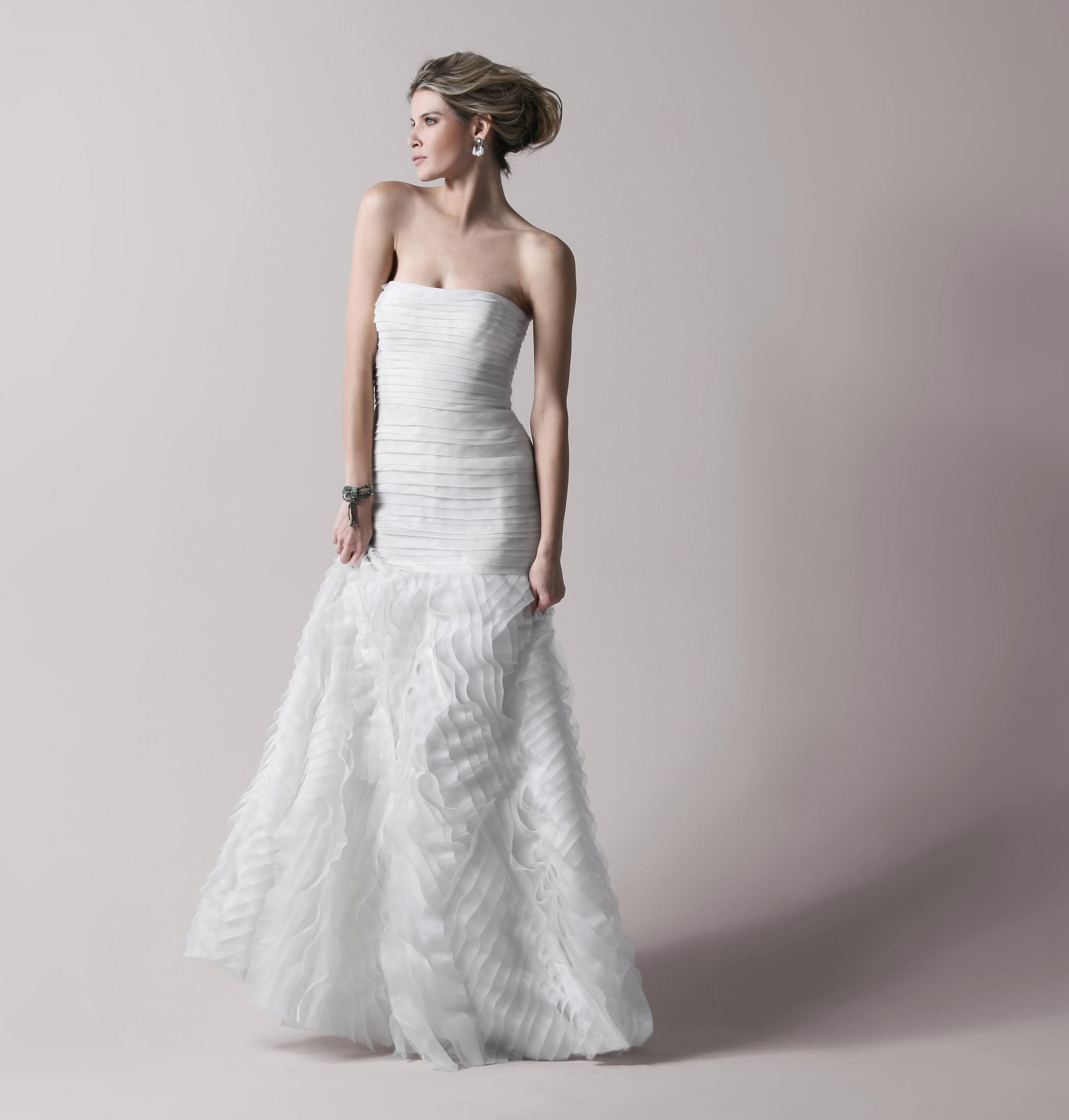 Marisa layered bridal gown, approx $1,082, BCBG.