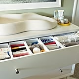 Instead of giving up the top drawer of the dresser for storing diapers, wipes, and toiletries, I wanted to use it for the boys' clothes. I used cheap drawer organizers to help keep everything tidy and separate and figured out the perfect solution for storing diaper-changing essentials close by.