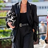 Go all-black with a bodysuit, high-waisted tailored shorts, and a blazer to take that summertime uniform into fall.