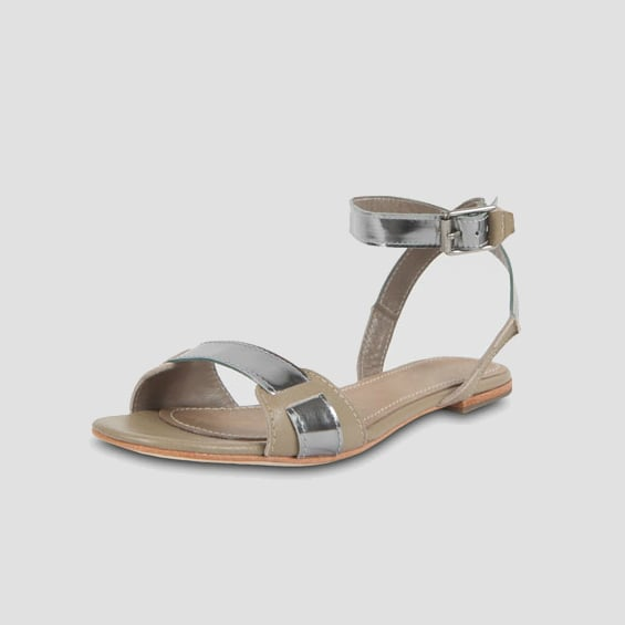 This two-tone, two-strap flat sandal is simple yet can add a touch of contemporary refinement to casual looks.   Elizabeth and James Two-Tone Flat Sandal ($198)