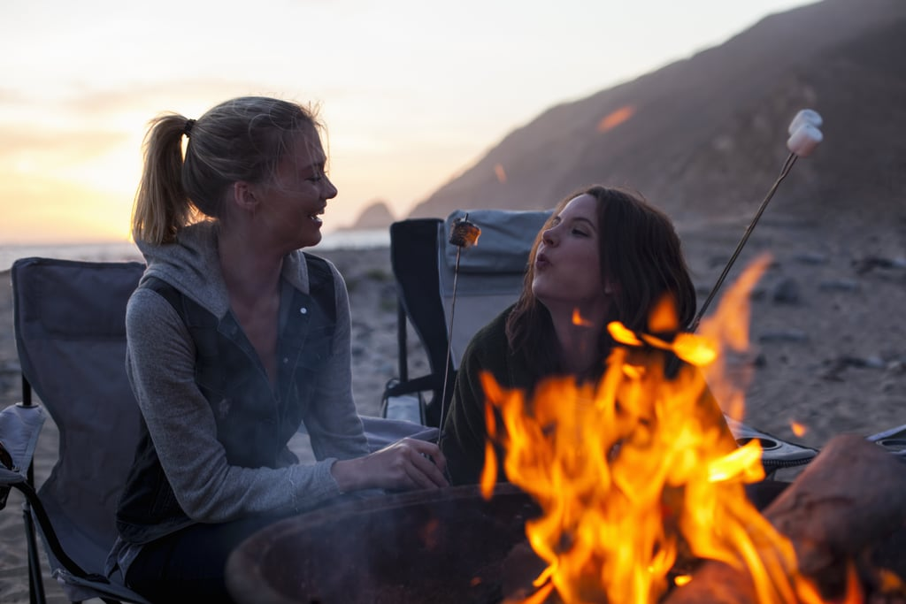 Cuddle at a campfire.