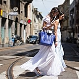 Style Your White Maxi Dress With a Bright Blue Bag