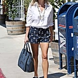 Ahoy, Reese! The petite blonde topped her sailor-chic J.Crew chinos with a white boyfriend blouse, navy sandals, and a blue Birkin while cruising around LA.