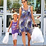 Halle Berry ran errands with Nahla wearing a peacock-print tank dress with tan T-strap sandals. Aviator sunglasses kept things in the cool territory. To get Halle's look, pair a bright dress with neutral sandals and sporty shades.