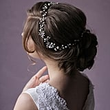 Ivory pearls and crystals make this headpiece ($70) look lovely from any angle.