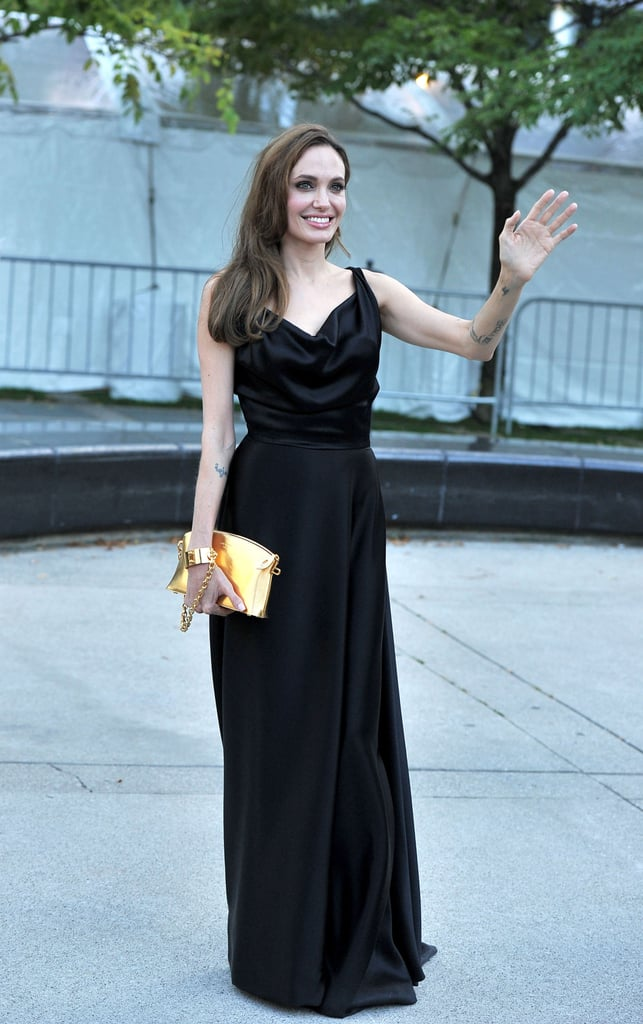 Angelina Jolie stayed true to form in an elegant black Vivienne Westwood gown at the Moneyball premiere.