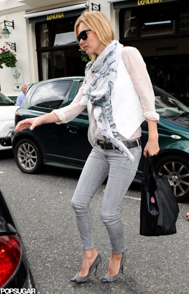 Kate Moss wore gray skinny jeans and a sheer white blouse while dining with friend Sadie Frost in London.