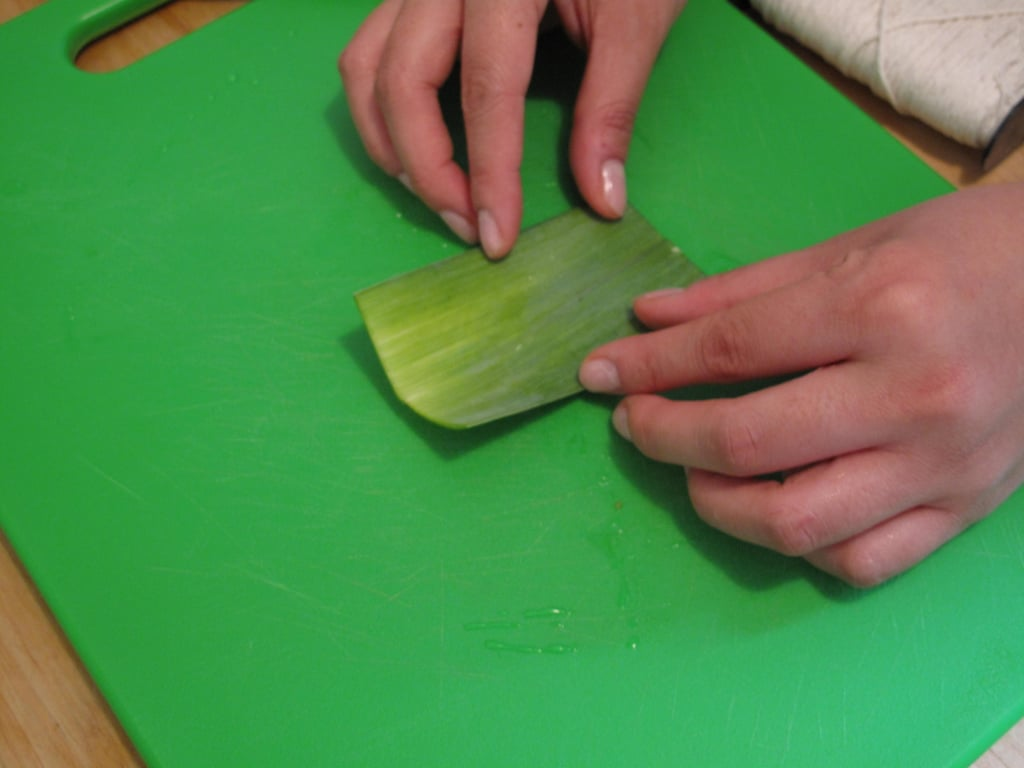 Begin by washing a leek leaf and sectioning it off to be about three to four inches long.