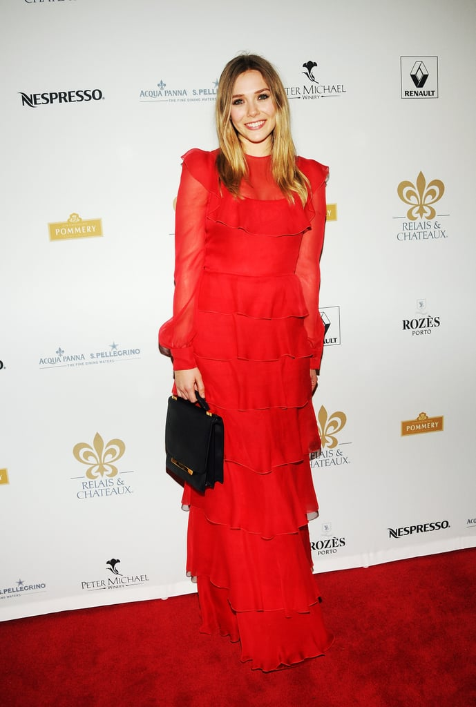 Elizabeth Olsen wore a bright red gown to the Grand Chefs Dinner in NYC.