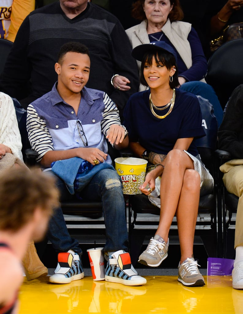 Our favorite basketball game look from Rihanna? The time she wore classic gray New Balance kicks to take in a December game with her little brother.