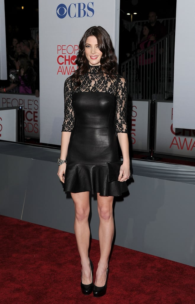Ashley Greene in a black mini dress on the red carpet at the People's Choice Awards.