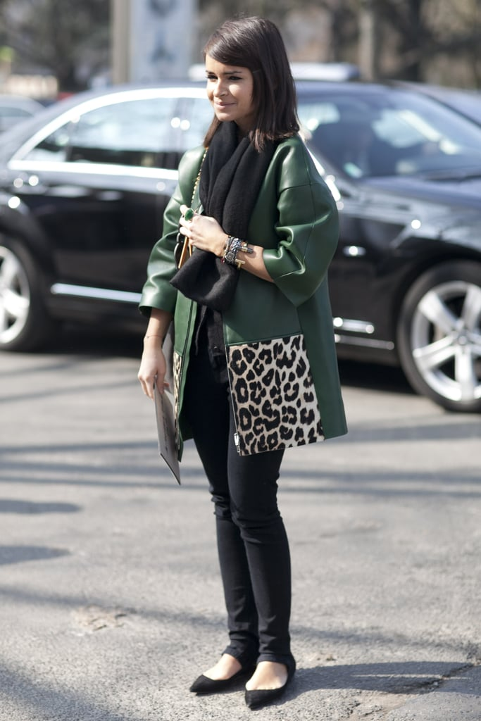 Miroslava Duma gave skinny bottoms a bold complement with an emerald-hued and leopard-print leather topper.