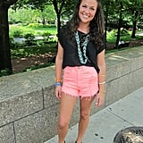 For a feminine approach to fest fashion, Hannah opted for pale-pink high-waisted denim cutoffs. For a sexier spin, she matched them with a sheer black tee that showed off a well-paired black lace bra.