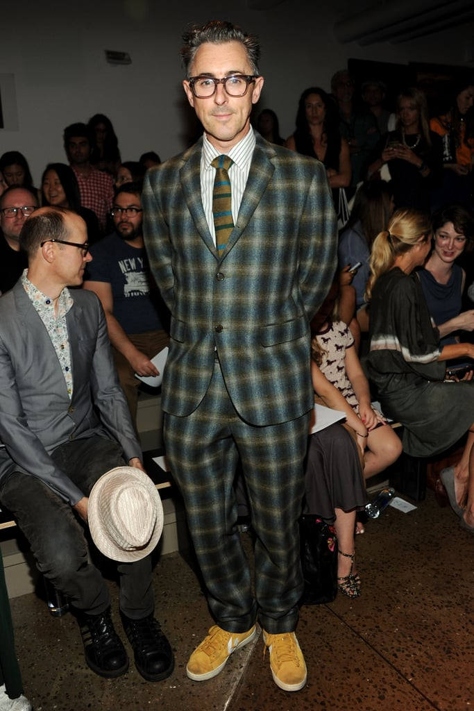 Alan Cumming looked dapper in a tartan-print suit in the front row at Costello Tagliapietra on Thursday.