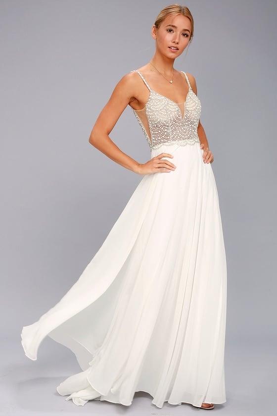 Twirl the night away in this Lulu's True Love White Beaded Rhinestone Maxi Dress ($252).