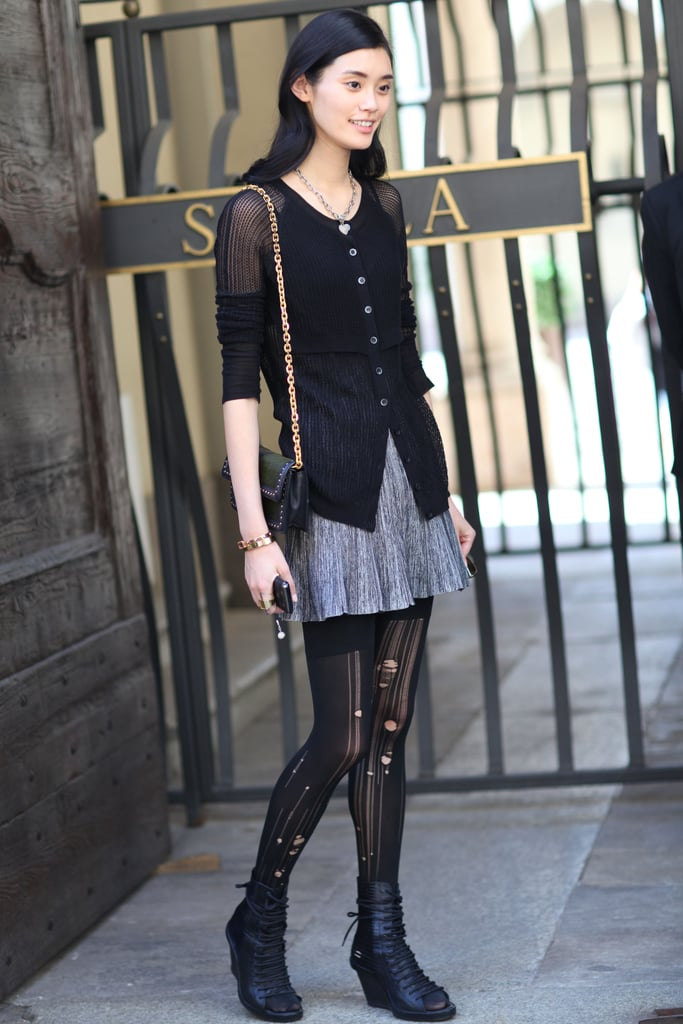 Tattered tights gave this mini and cardigan edgy undertones. Source: Greg Kessler