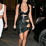 In a Daring Leather Dress With Side Cutouts