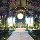 Transform an indoor space into a botanical garden with ivy-covered walls, flowers hanging from the ceiling, and potted plants lining the aisle.