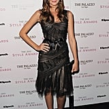 Odette Yustman chose a sheer, bow-tied, ladylike black dress.