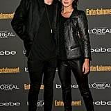 Shenae Grimes posed with her husband in a black leather jacket, leather pants, and printed sandals at the Entertainment Weekly pre-Emmys party in LA.