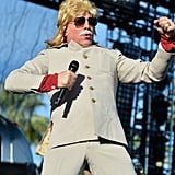 Maynard James Keenan from the band Puscifer donned a fun look complete with a wig and fake mustache.