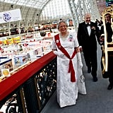 "A man carried a ""royal chair"" for the queen wannabe. She has the Diamond Jubilee look down, though."