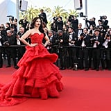 """Most celebrities stay away from wearing this color when they're on the red carpet but I love that Aishwarya dared to break the rules by wearing this red Ralph & Russo number. The dramatic tiers of the dress really made it pop against the red carpet."" — NR"