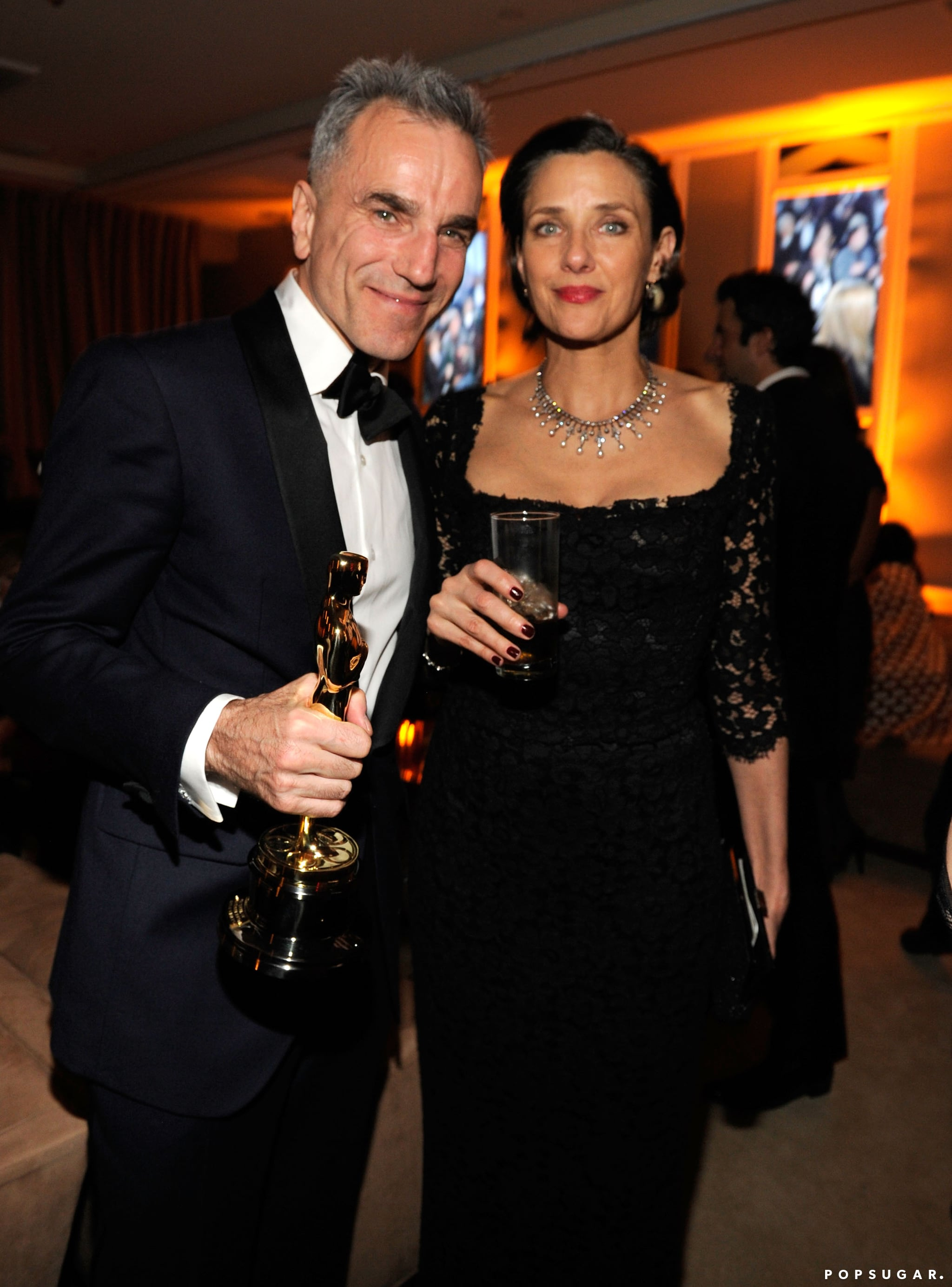 Daniel Day Lewis and Rebecca Miller made their way into the Vanity Fair after-party in LA.