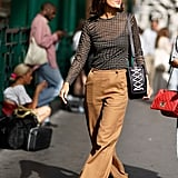 For '90s vibes, try a lug-sole shoe with wide-leg trousers.
