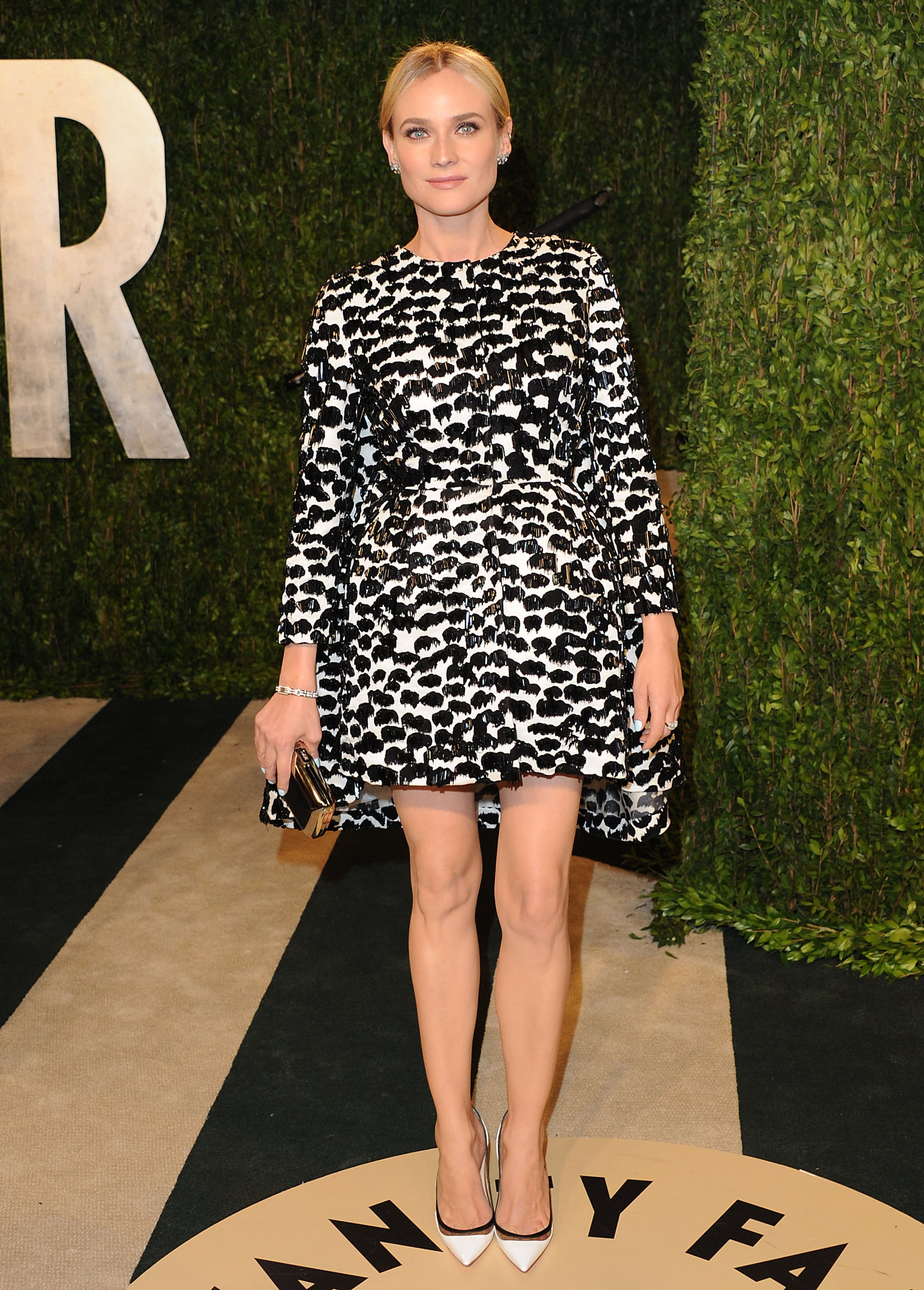 For Vanity Fair's 2013 Oscars bash, Diane Kruger went futuristic in a structured black and white Giambattista Valli creation, finished with a few sparkling adornments — Neil Lane earrings and a Jaeger-LeCoultre diamond-encrusted watch — a slicked-back bun, and trendy Christian Louboutin pumps.