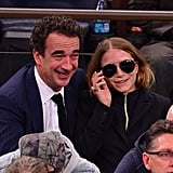 Olivier and Mary-Kate attended the New York Knicks game in 2014, and MK was, sure enough, modelling the go-to shape.