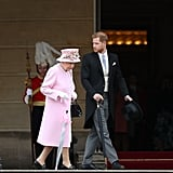 Prince Harry and Queen Elizabeth dressed to the nines for a garden party at Buckingham Palace in May 2019.