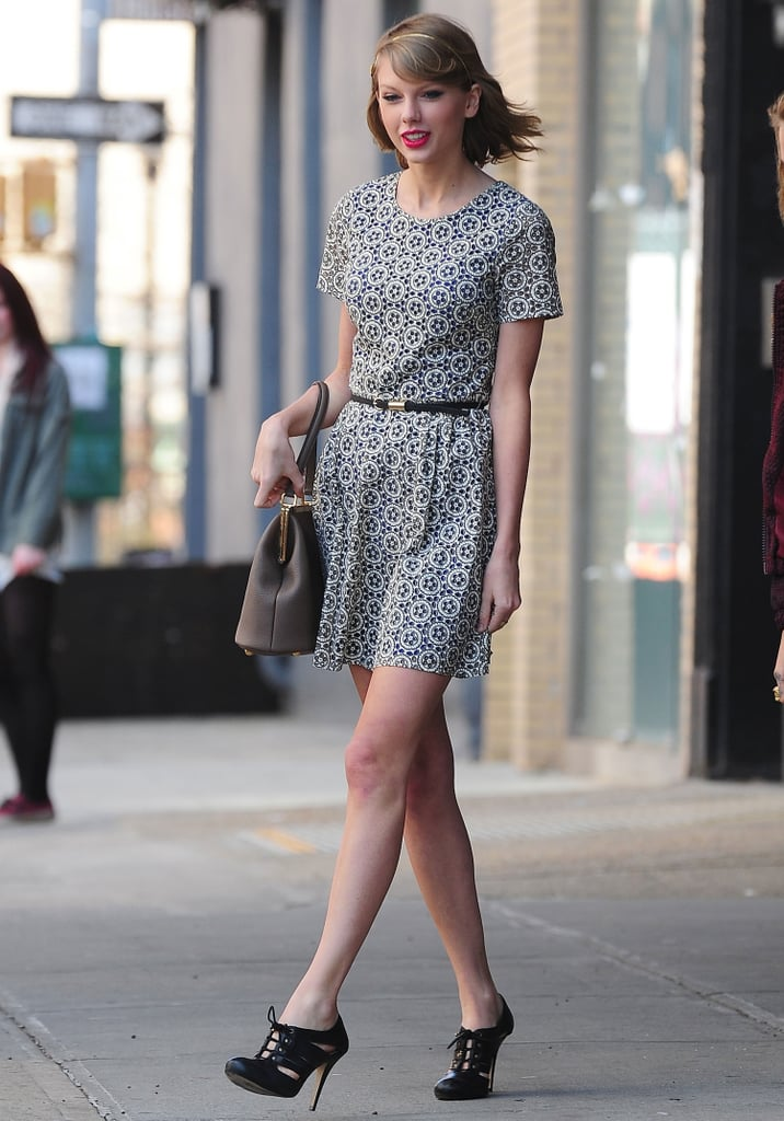 While out in NYC, Taylor showed off a sweet day dress but managed to throw a little sexy in there, too. While her handbag is ladylike, those heels add edge.  Source: Getty