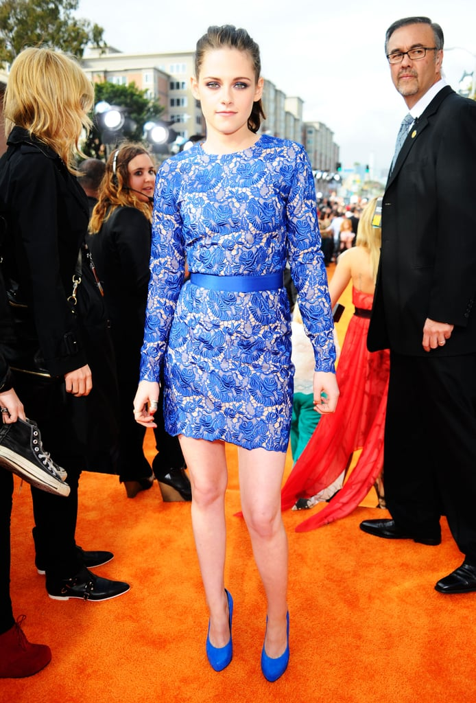 Kristen Stewart stood out in a gorgeous blue Stella McCartney dress and matching Barbara Bui heels on the Kids' Choice Awards orange carpet in LA this afternoon. She stopped to sign autographs for some fans on her way into the show, where she is up for favorite movie actress. Kristen is kicking off promotional work for Snow White and the Huntsman, though this nomination is primarily for her work in the Twilight series. Kristen stars in one of two adaptations of the classic fairy tale hitting the big screen this year, and we took a look at Snow White's transformation into a badass through the years. Kristen is also reportedly headed to Cannes next month to premiere On the Road, so it should be an exciting few months of red-carpet appearances for Miss Stewart.  Are you feeling Kristen's blue moment? Let us know and follow PopSugar on Twitter for updates from inside the show!