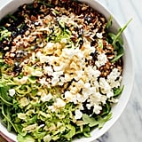 Shredded Brussels Sprouts and Arugula Salad With Sunshine Dressing