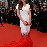 Cheryl Cole wore red to the premiere of Amour.