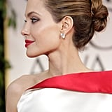 Angelina Jolie showed off her Lorraine Schwartz earrings.