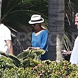 George Clooney and Stacy Keibler chatted with a friend.
