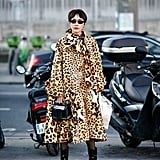 Style Your Leopard-Print Coat With: Sheer Tights, Black Boots, and a Bag